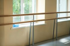Ballet barre in dance hall. Interior of dance ballet class. Barre and windows of ballet hall. Empty dance hall Stock Images