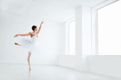 Ballet. Beautiful young ballerina in pointe royalty free stock photo