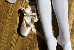 Ballet Break. A ballet dancer taking a break from her pointe class on a sunny day stock images