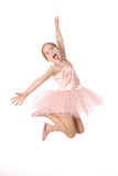 Ballet child making a crazy face. Isolated on white Royalty Free Stock Images