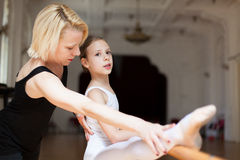 Ballet class. Teacher and student during ballet class stock images