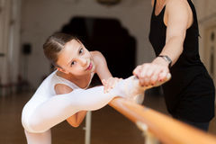 Ballet class. Teacher and student during ballet class royalty free stock image