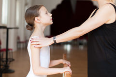 Ballet class. Teacher and student during ballet class royalty free stock photo