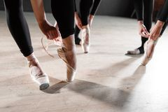 The ballet concept. Pointe shoes close up. Young ballerina girls. Women at the rehearsal in black bodysuits. Prepare a. Young ballerina girls. Women at the Stock Photography