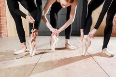 The ballet concept. Pointe shoes close up. Young ballerina girls. Women at the rehearsal in black bodysuits. Prepare a Stock Photography
