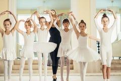 Attractive Slim Ballerina Woman Teach Her Pupils In Ballet Class Stock  Image - Image of little, ballet: 166861303