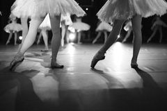 The at of ballet dance. Graceful dancing ballerinas legs on stage, monochrome Royalty Free Stock Photo