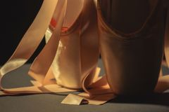 Ballet dance shoes. On dark background Royalty Free Stock Photography