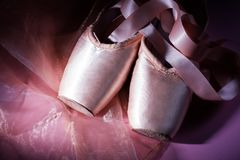 Ballet dance shoes. On pink background Royalty Free Stock Photography