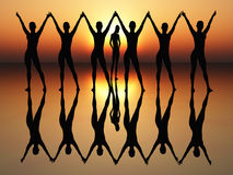 Ballet dancer. Dancing women in the rising sun as symbol for wealth, joy, elegance and success Stock Photography