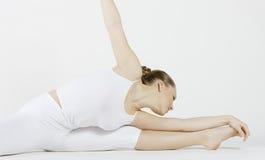 Ballet dancer. Young ballet dancer doing stretching Stock Photo