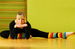 Ballet dancer. Doing stretching exercise on a floor Royalty Free Stock Photo