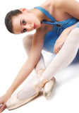 Ballet dancer. In tutu stretching royalty free stock photo