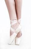 Ballet-dancer. Legs in shoes of woman who dancing in ballet Royalty Free Stock Photos