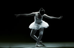 Ballet dancer-action. With dark background Stock Images
