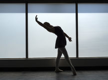 Ballet Dancer Backbend Silhouette. A silhouette of a ballet dancer in dance class doing a back bend Royalty Free Stock Photo