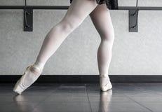 Ballet Dancer at Barre- tendu derrière en fondu. Ballet dancer at the barre in her pointe shoes doing syllabus work Stock Photography