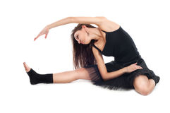 Ballet dancer in black dress doing exercises Royalty Free Stock Photos