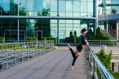 Ballet dancer in casual clothes standing on Stock Photo