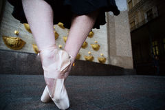 Ballet dancer on the city street stock images