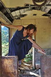 Ballet dancer dancing. Beautiful ballet dancer dancing in an old abandoned train Royalty Free Stock Images