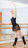 Ballet dancer dancing near barre in dancing hall Royalty Free Stock Images