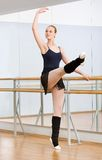 Ballet dancer dancing near barre in studio Royalty Free Stock Image