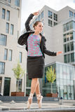 Ballet dancer dancing on street. Ballet dancer dressed in business clothes dancing on street Royalty Free Stock Photos