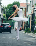 Ballet dancer en pointe on street