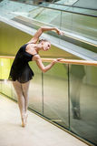 Ballet dancer at escalator Stock Images
