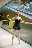 Ballet dancer at escalator Royalty Free Stock Photography