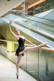 Ballet dancer at escalator Royalty Free Stock Photos