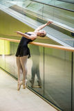 Ballet dancer at escalator Stock Images