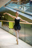 Ballet dancer at escalator Stock Photography