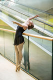 Ballet dancer at escalator Royalty Free Stock Images