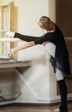 Ballet dancer exercising at the barre Royalty Free Stock Photo