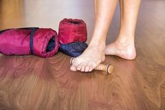 Ballet dancer feet near a pair of foot warmers. In bordeaux color royalty free stock image