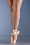 Ballet dancer feet on pointes. Close up of lady ballet dancer legs and feet, standing on her toes Stock Images