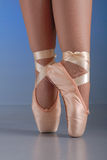 Ballet dancer feet on pointes. Close up of lady ballet dancer legs and feet, standing on her toes Royalty Free Stock Image