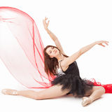Ballet Dancer. On the floor with a graceful pose Stock Image