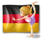 A ballet dancer in front of the flag of Germany Royalty Free Stock Images