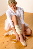 Ballet dancer getting ready for studio performance. Woman ballerina dressing Royalty Free Stock Image