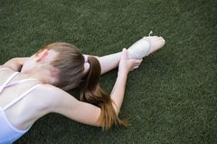 Ballet stretching in the grass stock image