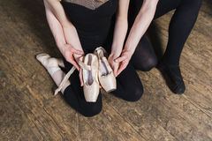 Ballet dancer holding a ballet pointe stock images