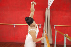 Ballet Dancer Holding Barre While Practicing In Studio Royalty Free Stock Photos