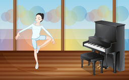 A ballet dancer inside the studio with a piano Royalty Free Stock Photos