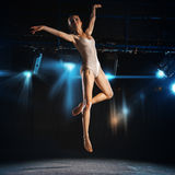 Ballet dancer in jump on theater stage Stock Photos