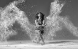 Ballet dancer jumping with flour stock photos