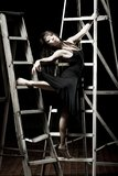 Ballet dancer on ladders Royalty Free Stock Photo