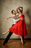 Ballet dancer and latin dancer mix the styles together. Royalty Free Stock Images